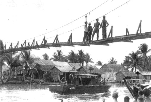 Thu Thua suspension bridge, under construction by Seabee Team 0604 in Long An Province. THis 50 meter footbridge was completed by Team 0410.<br /> Photo: Seabee Team Deployment Completion Report