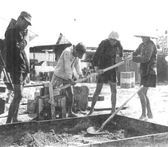 Vietnamese prisoners operate CINVARAM machine to produce soil-cement block in Tay Ninh Province. Although unusual to have prison laborers/trainees, Team 0805 had ten such individuals assigned.<br /> Photo: Seabee Team Deployment Completion Report