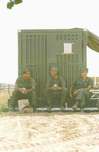 BU1 Jim Lucey, HM2 Kenny DePriester, and Lt. Dick Truman kickin' back over a beer.