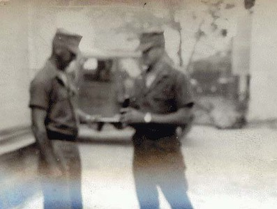 HM2 Kenny DePriester receiving the Purple Heart from Lt. Dick Truman.