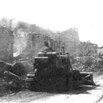 EOH3 Antonio of Team 1011 clears away bomb-damaged structures in Ving Long, Vinh Long Province: the aftermath of Tet 1968.<br /> Photo: Seabee Team Deployment Completion Report