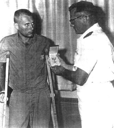 LTJG Frank A. Peterlin, CEC, USNR, Officer in Charge, Team 1104, receives the Silver Star from CDR William Barron, Commanding Officer, NMCB-11, for his herioc actions in the battle at Dong Xoai in June 1965.<br /> Photo: Seabee Team Deployment Completion Report