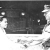 LTJG A.H. Sommers awarding a graduation certificate from 13301's Mechanic Training Program to a newly-trained Vietnamese.<br /> Photo: NMCB-133 Cruisebook