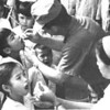 13301 team member HMC G.P. McCloskey and Vietnamese interpreter-Corpsman giving polio vaccine to school children at the Nhon-Nhoung school in Tan An.<br /> Photo: NMCB-133 Cruisebook