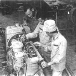 CM1 Falkenstein of Team 4002 instructs his CM trainees how to adjust the valve rocker arms on a diesel engine. THis engine and gererator were put into operation for Dong Toi Village, Go Cong Province.<br /> Photo: Seabee Team Deployment Completion Report