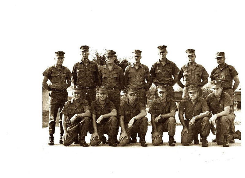 "Seabee Team 7401<br /> Front Row:BU2 James Higgins-CM3 ""Willie"" Williams-EO3 Rick Butler-SW1 Chris Meeks-UT1 Richard Cifranic-HM2 Tim Henderson<br /> Back Row: LTjg Robert Cary-EO1 Daryl Sumpter-EA2 Ed Greene-CE3 Larry Bowen-BU2 Jerry Petty-CM1 Walt Butler-BUCS Dewey Ray"