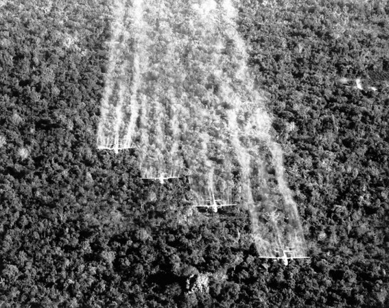 """USAF UC-123 providers spray defoliant chemicals on Vietnamese jungle. Harmless to animal life, chemicals are temporarily effective against vegitation.""<br /> <br /> All Hands Magazine March 1967"