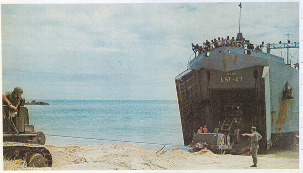 36 men were formed as Detail Juliett and participated in the only amphibious landing made by NMCB-74. On 13Feb71 the men, unsupported by any friendly forces, landed at Mui Dinh. Immediately after landing from the LST, defensive positions were established as bulldozers coming off the LST formed a sand berm for the Seabees immediate protection<br /> Photo from NMCB-74 Cruise Book