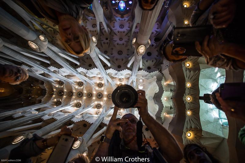 Bill taking picture in the mirror on a table in La Sagrada Familia