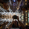 Bill taking picture in the mirror on a table in La Sagrada Familia