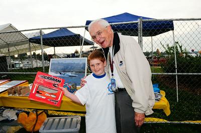 Will at volunteer dinner, winning bid on hydro toy