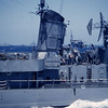 Summer 1955 in background USS Lake Champlain CV 39 preparing to come alongside.