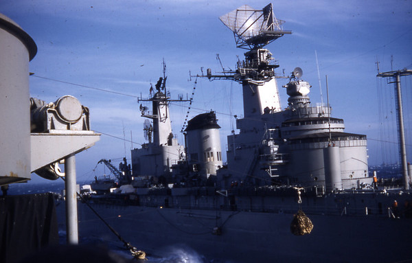 Summer 1955 - USS North Hampton CLD 1 receiving supplies.
