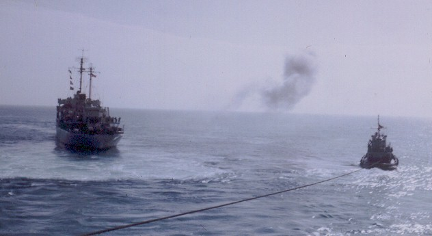 The Altair being pulled off a reef by a Coast Guard Cutter and a tug boat.  The Cutter was using a thin steel cable while the tug was using a hawser.