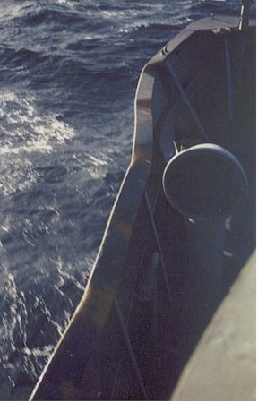 The Altair's port side bow after a collision with the U.S.S. Coral Sea, CVA-43.  The damage occurred while replenishing the Coral Sea in rough seas.  Damage to the Altair included other parts, booms, etc.  John also notes that he had a friend aboard the Coral Sea that was seven decks below and did not know anything had happened until they blew collision quarters.
