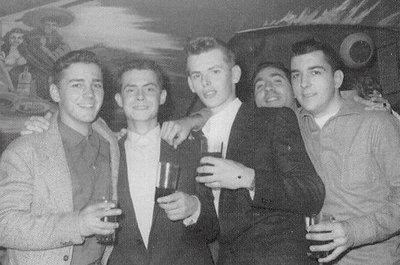 Neil Van Fleet, B.X. Wabich, Vincent Burling and Charles Brecheisen (all front row) enjoying New Years Eve at The Tequila Bar, Barcelona, Spain, 1961.
