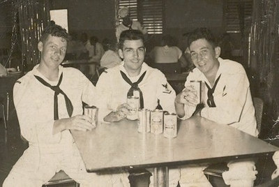 Charles Brecheisen (center) and MM Whalen (left) enjoying liberty at the EM Club in Guantanamo Bay, Cuba, 31 July 1960.