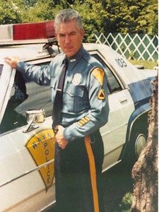 """After leaving the Navy, John attended basic training with the NJ State Police, was a Passaic County Sheriff's Officer for 4 years and retired from the Wayne, NJ Police Department.  John had a distinguished law enforcement career and was honored by the Wayne Elks as """"Policeman of the Year"""" in 1986."""