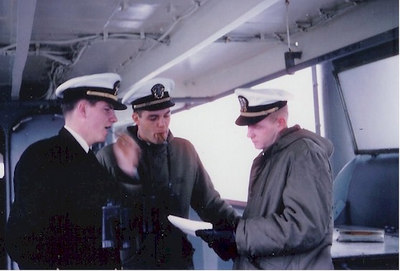 On the bridge of the Altair in March 1961.  Mr. Snideman (L), Mr. Davies (R) and Mr. Price (R), who had the Conn.