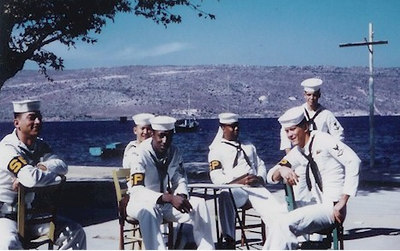 The Altair Shore Patrol at Suda Bay, Crete in November 1961.  Front row left is Andre DeLeon, center is Bobbie Sullivan; back row center is John Weldon; and back row right is Tom Planes.