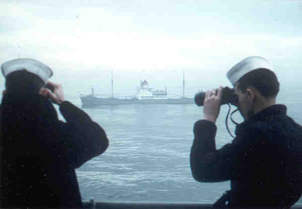 Jim Spiegel & Robert Lecher observing Soviet freighter while on Sea and Anchor detail in Naples 1961