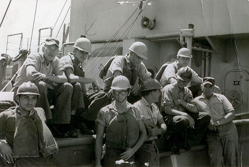 Taken during a log rep on the forward hatch cover sometime 1962-1963.<br />  Front Row L-R Valentine Vit SN, Harold Wales SN, Pete Athas SN, John etheny BM3, Tennis Hatfield SN; Back Row L-R Unknown, Tommy Lee BMSN, Bill Bohm BM3, Unknown