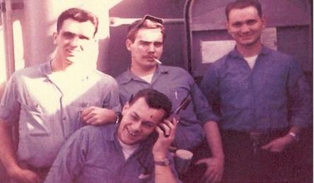 The Radio Room crew; Harlan Schnarrs, Paul Meierdierks, Tex (RM2) and Dean.  Paul and Dean were the speed key operators.