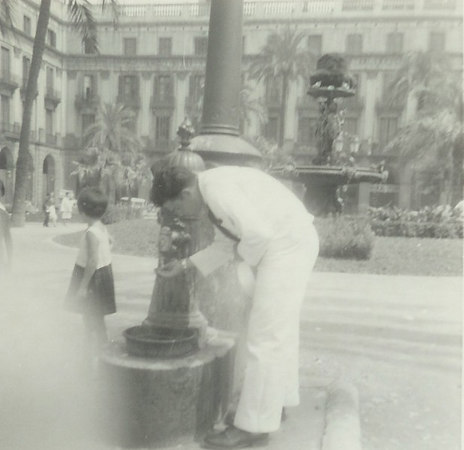 Louis Colandrea getting a drink of water in Naples 1962.
