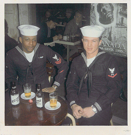 1965, Barcelona Spain, Pettaway, Mike, and our San Miguel beer in a sidewalk cafe.