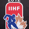 Logo, World Junior Championship - The  2012 U.S. National Junior Team defeated the Switzerland National Junior Team  7-3 in a preliminary game December 22, 2011, at the Edgeworth Centre in Comrose, Alberta, Canada.
