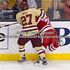 Quinn Smith (BC - 27), Evan Rodrigues (BU - 26) - The Boston College Eagles defeated Boston University Terriers 3-2 in overtime in the finals of the 60th Beanpot Tournament on February 13, 2012, at TD Banknorth Garden in Boston, MA.
