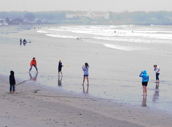 Kathryn Rizzo, her brother, and children play wiffle ball on Gooch's Beach in Kennbunk, Maine.