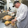 Sean Patrick's Restaurant in Lunenburg will be serving up some turkey on Thanksgiving Day. Owner/Chef Sean Flannagan cuts up a butternut squash on Friday, Oct. 25, 2019. SENTINEL & ENTERPRISE/JOHN LOVE