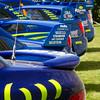 Line of Subaru Impreza 555 Rally Cars