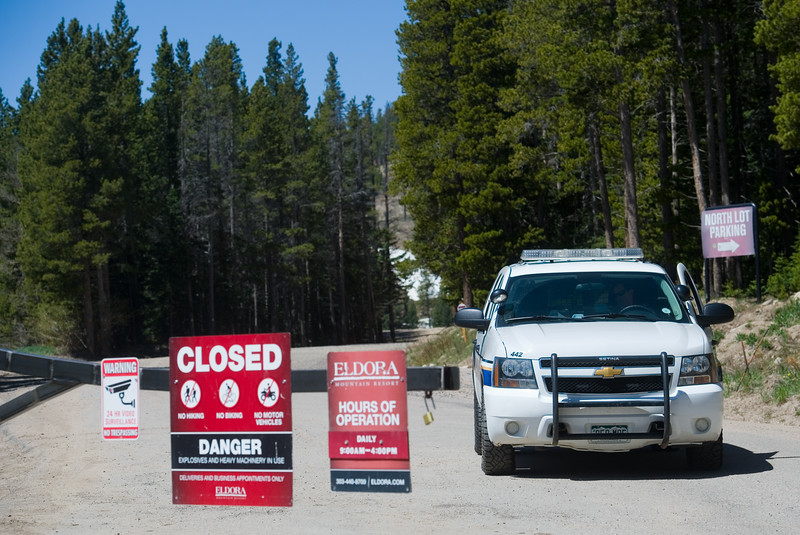 "A Boulder County sheriff's deputy blocks the entrance to Eldora Mountain Resort on Thursday as search teams comb the area for human remains.<br /> More photos:  <a href=""http://www.dailycamera.com"">http://www.dailycamera.com</a><br /> Autumn Parry/Staff Photographer<br /> June 2, 2016"