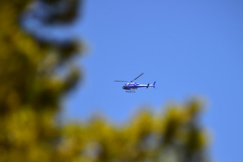 "A helicopter circles the area as search teams comb Eldora Mountain Resort for human remains on Thursday,  after a boot with a human foot and leg bones inside it was found on the property.<br /> More photos:  <a href=""http://www.dailycamera.com"">http://www.dailycamera.com</a><br /> Autumn Parry/Staff Photographer<br /> June 2, 2016"
