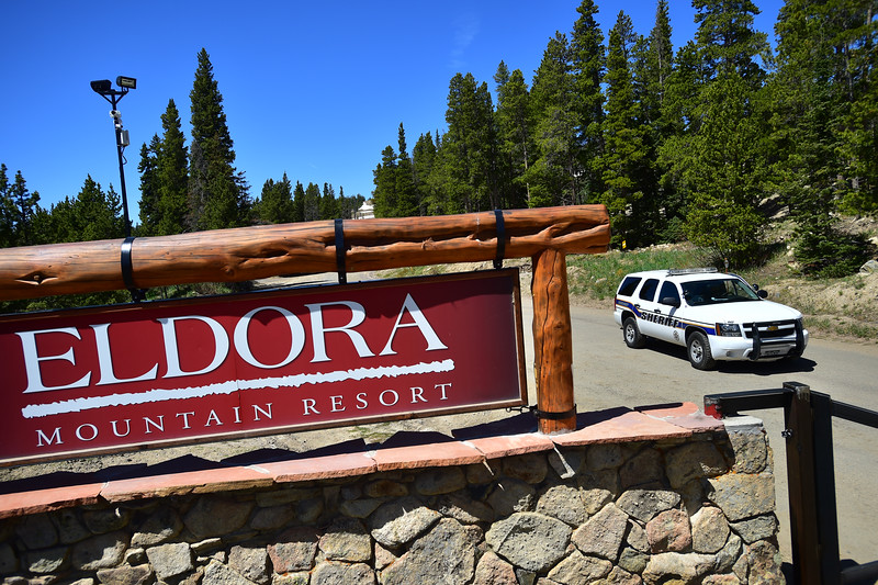 """A Boulder County sheriff's deputy blocks the entrance to Eldora Mountain Resort on Thursday as search teams comb the area for human remains, after a boot with a human foot and leg bones inside it was found on the property.<br /> More photos:  <a href=""""http://www.dailycamera.com"""">http://www.dailycamera.com</a><br /> Autumn Parry/Staff Photographer<br /> June 2, 2016"""