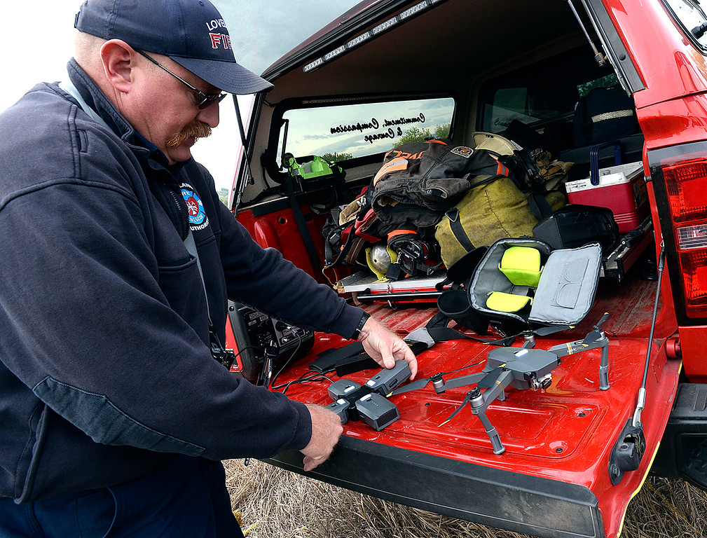 . Loveland Fire Rescue Authority Battalion Chief Jason Starck readies a drone to use while searching for a missing kayaker Monday, Oct. 1, 2018, at Buckingham Lake in west Loveland.  (Photo by Jenny Sparks/Loveland Reporter-Herald)