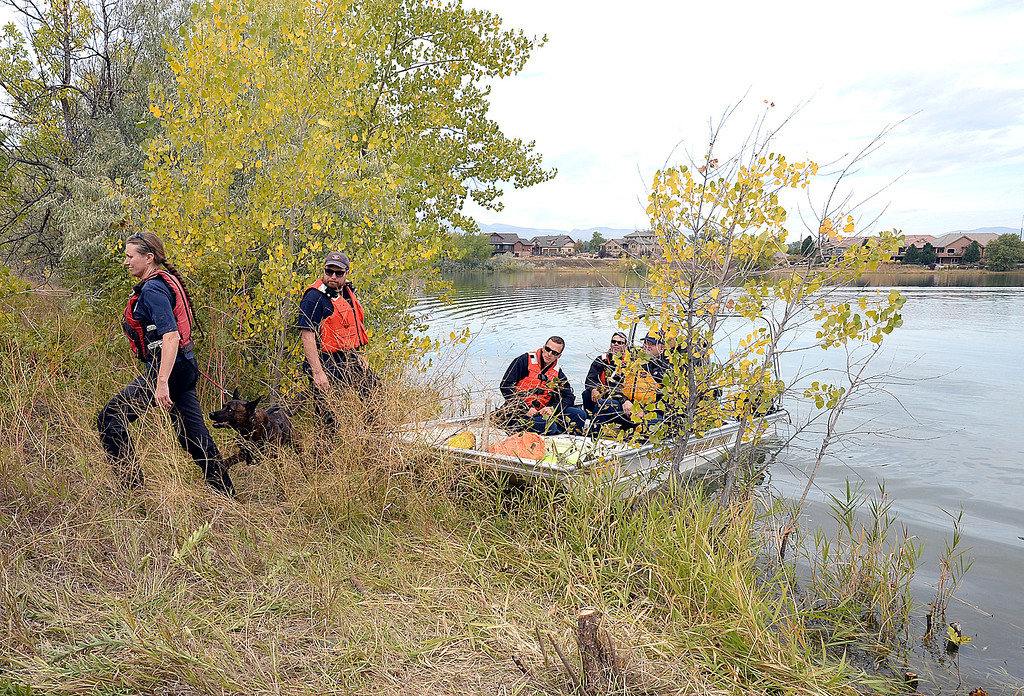 . Larimer County Search and Rescue team member Denise Alvord leads Riot, her K9 who specializes in finding cadavers, off the shore after searching for a missing kayaker Monday, Oct. 1, 2018, at Buckingham Lake in west Loveland.  (Photo by Jenny Sparks/Loveland Reporter-Herald)