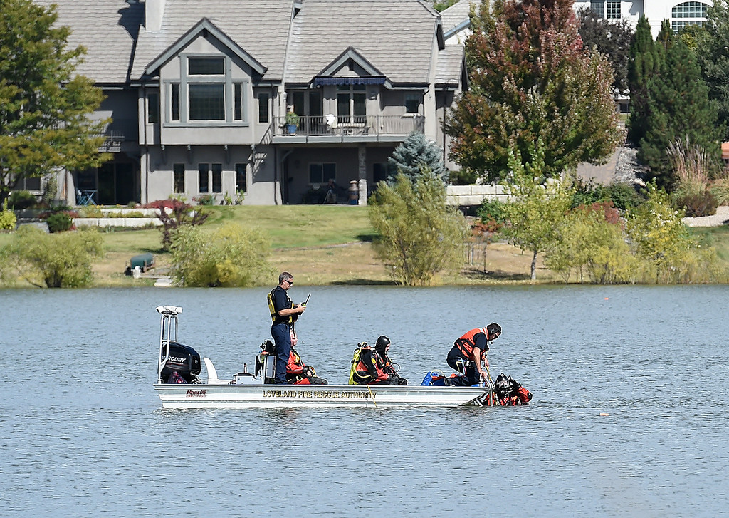. Loveland Fire Rescue Authority Special Operations Team dive members and Larimer County Search and Rescue divers prepare to search under water for a missing kayaker Monday, Oct. 1, 2018, at Buckingham Lake in west Loveland.  (Photo by Jenny Sparks/Loveland Reporter-Herald)