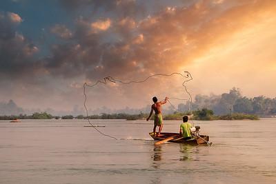 Lao fishermen on Mekong river
