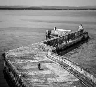 Going Fishing Burghead Outer Pier Northeast Scotland 2 B&W