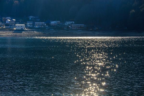 Twinkle stars falling on the spring lake, Lake Aoki, Nagano,japan