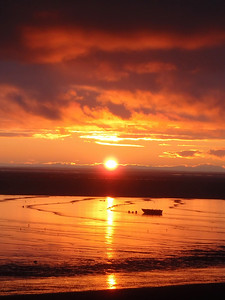 A sunset over a setnet skiff in Naknek, Alaska