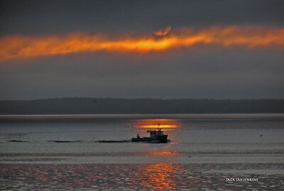 The sun breaks through the clouds on Penobscot Bay.....