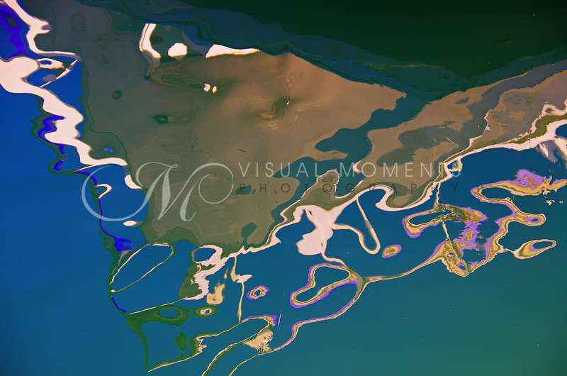 Oil Slick on the Water,  Creates Strange Patterns & Colors
