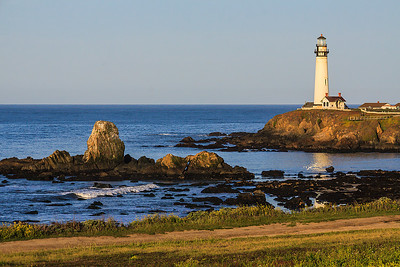 Sunrise at Pigeon Point Lighthouse with tower reflecting in tidepool