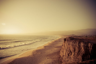 Hazy sunset at the beach in Half Moon Bay, California.