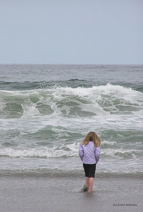 A girl braves the chilling waters at Short Sands Beach.