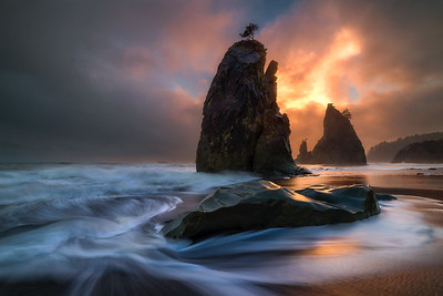 Moody sunrise light creates the scene at Rialto Beach, Washington